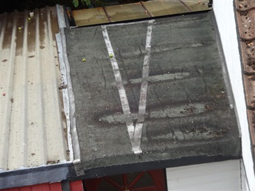 flat roof sunk and patched